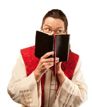 A female pastor looking over her bible.